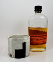 black square rocks glass with bottle