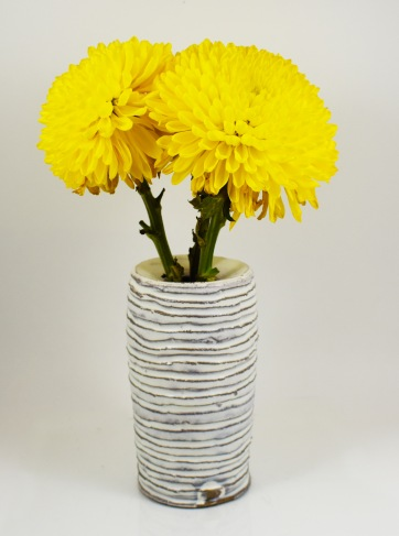 lined drop rim vase with yellow flowers