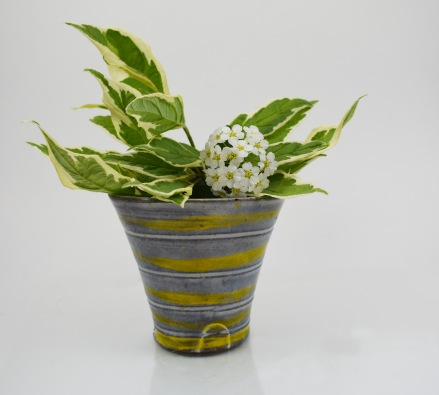 small yellow striped triangle vase