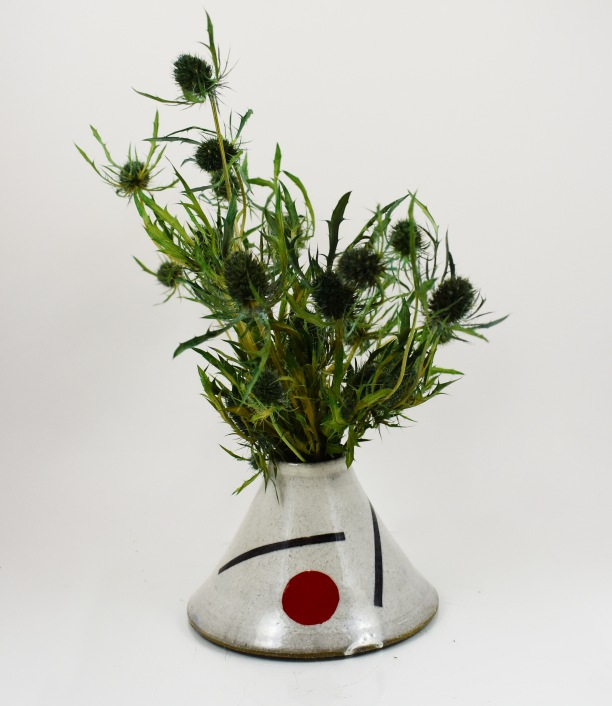traingle vase with red circle