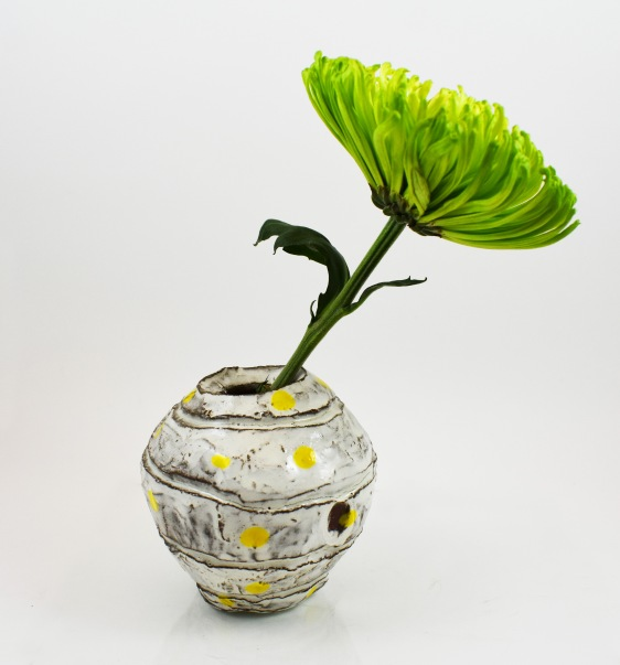 yellow dot orb vase and flower