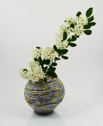 yellow dot orb vase with flowers
